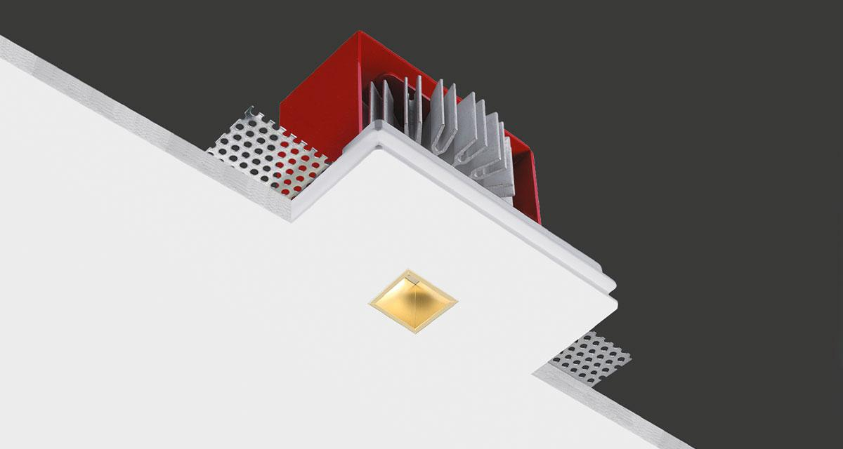 "GENIUSQUARE BRASS | 125 x 100 mm (4.92"" x 3.94"") rectangular recessed luminaire with 20 x 20 mm (0.79"" x 0.79"") brass light emission hole"